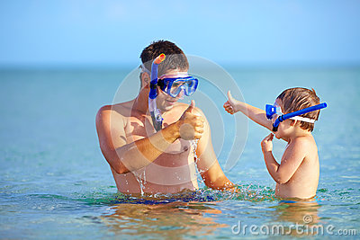 Happy father and son snorkeling