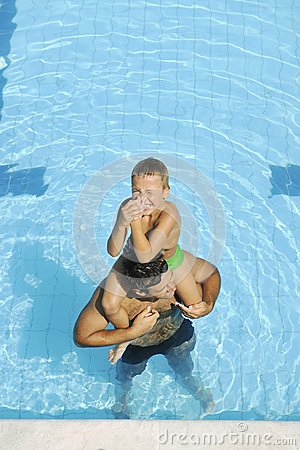 Happy father and son at swimming pool