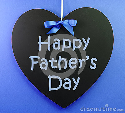 Happy Fathers Day message written on a heart shape black blackboard