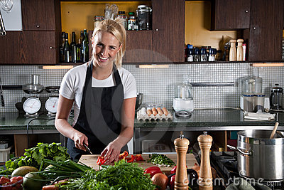 Happy female chef in the kitchen