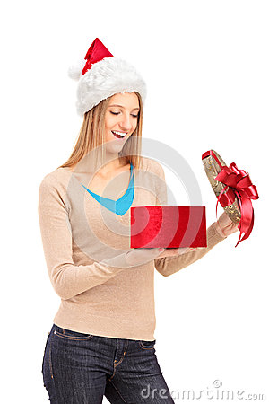 Happy female with christmas hat opening a gift