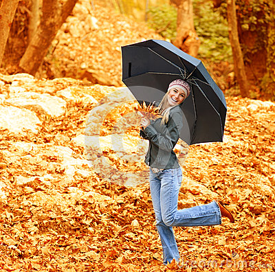 Free Happy Female Dancing With Parasol Royalty Free Stock Photography - 27354127