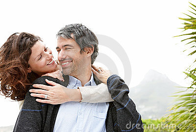 Happy female embracing her husband from behind