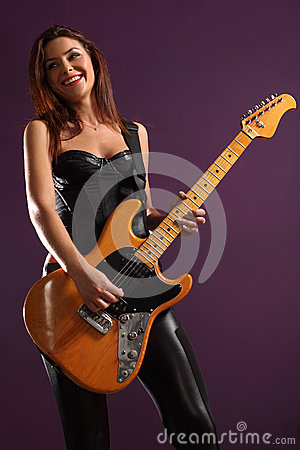 Happy female guitarist