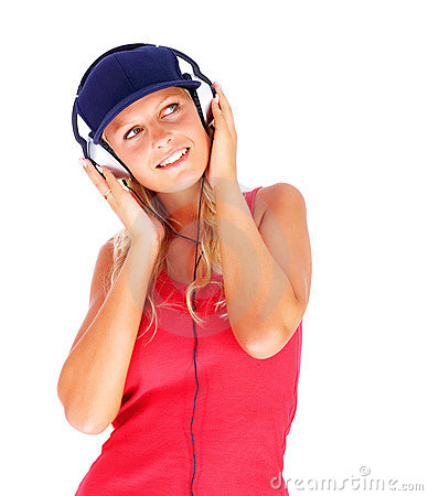Happy female hearing music on the headphones