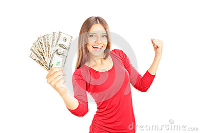 Happy female holding US dollars and gesturing happiness