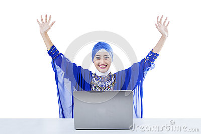 Happy female muslim and laptop - isolated