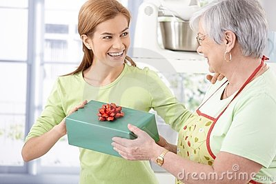 Happy female presenting mother with gift
