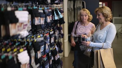 Happy female shoppers buying gifts for husbands stock footage