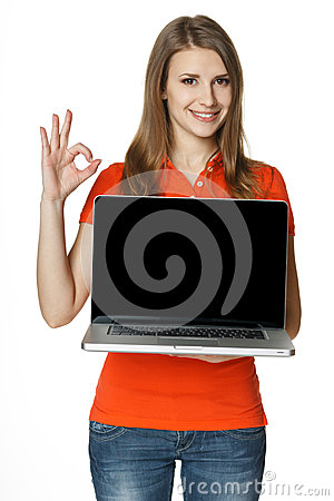 Happy female showing a laptop screen and gesturing OK
