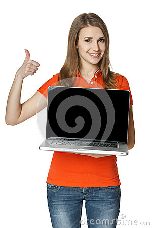 Happy female showing a laptop screen and gesturing thumb up