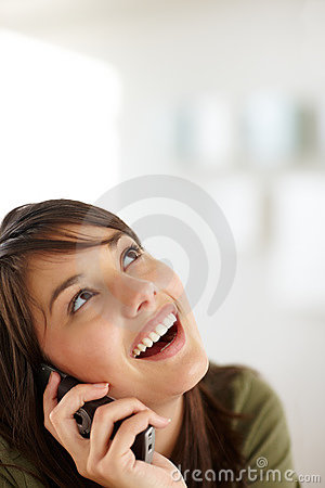 Happy female speaking on the mobile