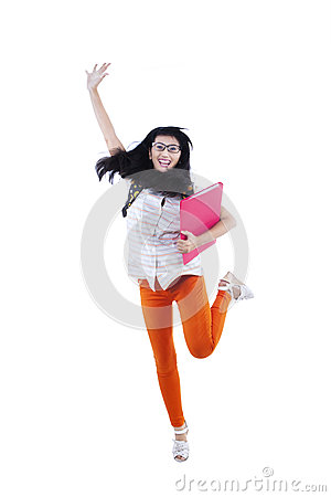 Happy female student jumping - isolated