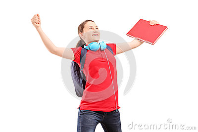A happy female student with raised hands gesturing happiness