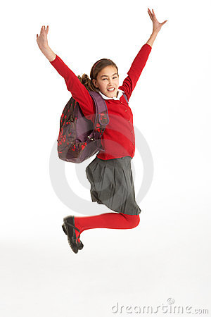 Happy Female Student In Uniform Jumping In Air