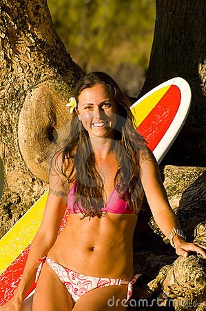 Happy female surfer