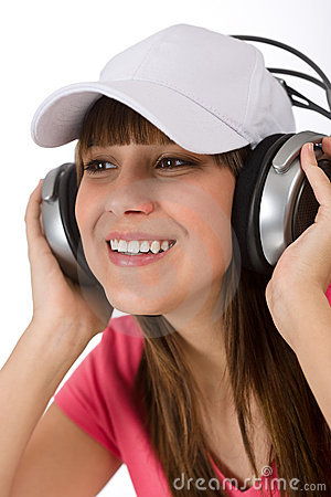 Happy female teenager enjoy music