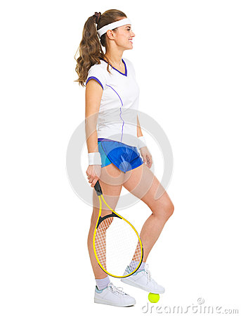 Happy female tennis player with racket and ball