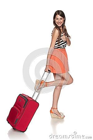 Happy female traveler showing thumb up