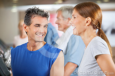 Happy fitness trainer and woman