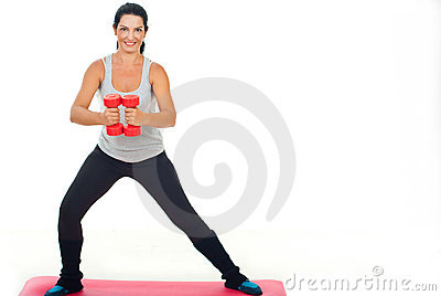 Happy fitness woman with dumb bell
