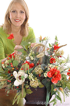 Happy florist making flower arrangement