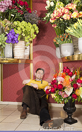 Happy florist resting after hard work