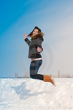 Happy flying in winter snow time by young woman