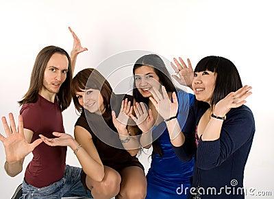 Happy four friends studio shot