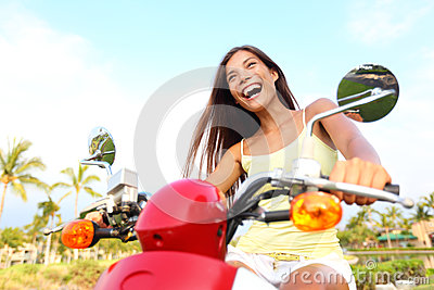 Happy free asian woman on scooter
