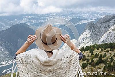 Happy free woman enjoying trip adventure travel with folk hat sh