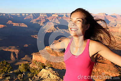 Happy freedom woman in Grand Canyon