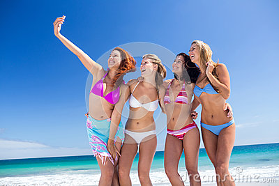 Happy friend doing selfie with smartphone