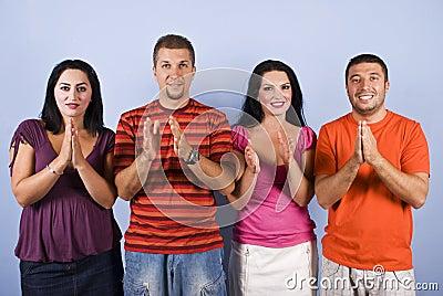 Happy friends applauding