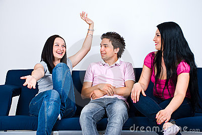 Happy friends  conversation on couch