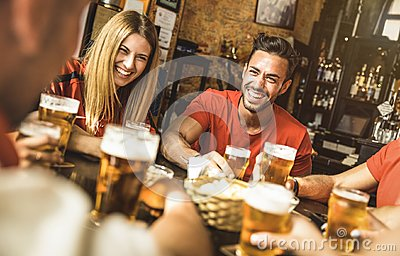 Happy friends group drinking beer at brewery bar restaurant Stock Photo