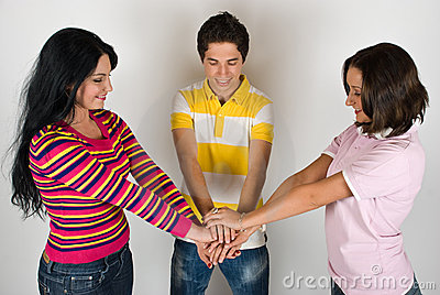 Happy friends with hands united