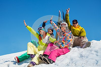 Happy friends on snowboard resort