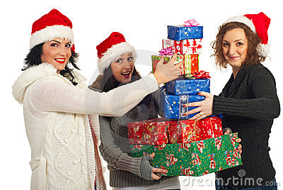 Happy friends with stack of Christmas gifts