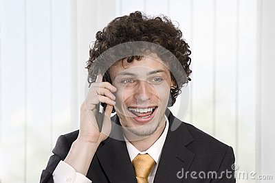 Happy gesturing business man with mobile phone