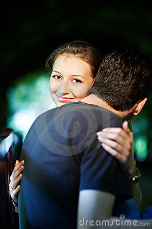 Happy girl in the arms of her fiance