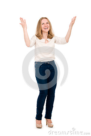 Happy girl with arms raised. Isolated