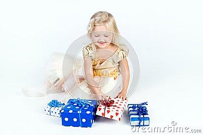 Happy girl arranging presents