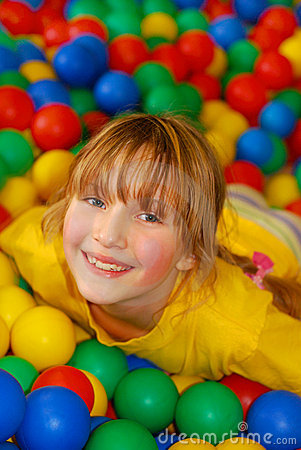 Happy girl in ball pool
