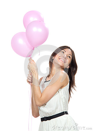 Happy girl with balloons as a present for birthday party smilin
