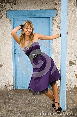 Happy girl in a blue door