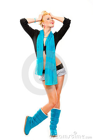 Happy girl with blue scarf holding hands near head