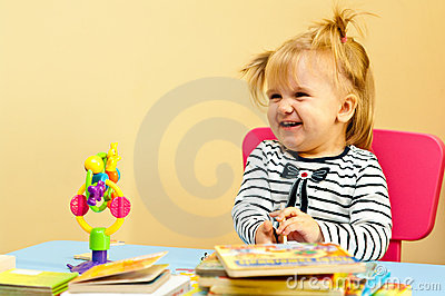 Happy girl with books and toy