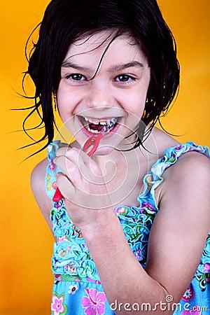Happy girl brushing teeth
