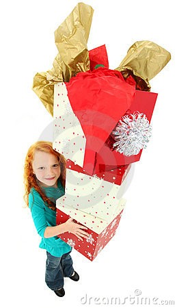 Happy Girl Child Carrying Stack of Gift Boxes